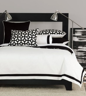 interior-decorations-attractive-white-comforter-feat-black-graphic-cover-cushions-on-black-wooden-bed-frames-aso-two-architecture-lamps-in-modern-black-and-white-room-decor-furnishing-in-simple-bedr